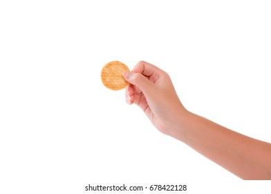 Young woman hand holding biscuit isolated on white background.