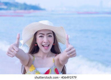 Young woman with Hand up Like on the beach