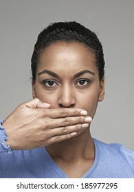 Young woman with hand over mouth