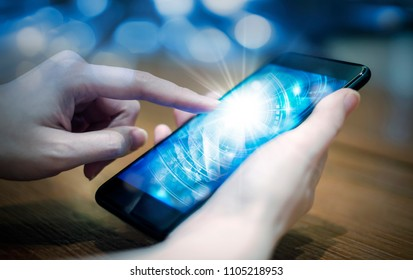 Young woman hand touching digital technology by using mobile phone