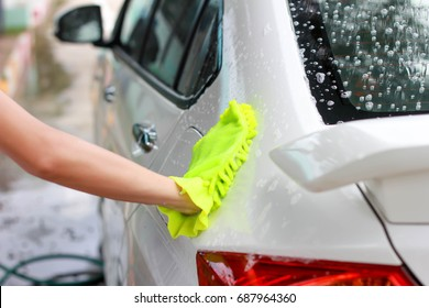 Young woman hand washing car cleaning