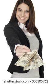 Young woman handing over money. Focus is on money.