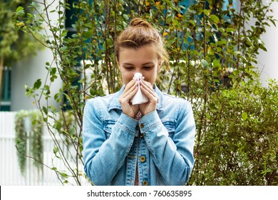 Young woman with a handkerchief - the girl has an allergy