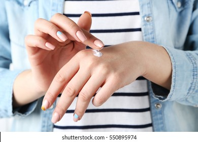 Young woman hands with cream