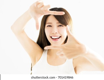 young woman hands making frame gesture