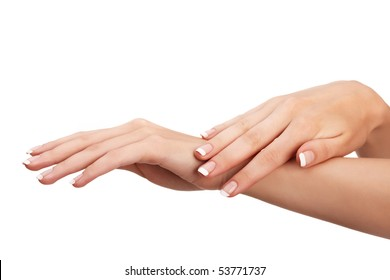 """Young woman hands with natural """"french"""" manicure over isolated white background"""