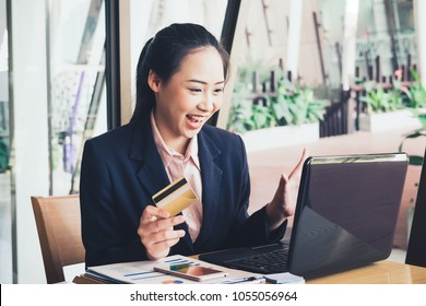 Young woman hands using Laptop to shopping online at the city. Easy E-commerce Website Shop by Smartphone and Laptop. Business and modern lifestyle concept