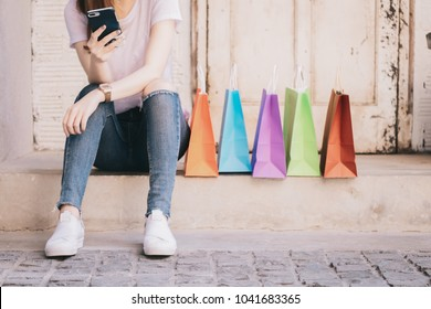 Young woman hands using smartphone to shopping online at the city. Easy E-commerce Website Shop by Smartphone, iPhone, iPad and Laptop. Business and modern lifestyle concept