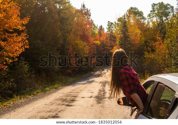 young-woman-hanging-out-car-600w-1835012