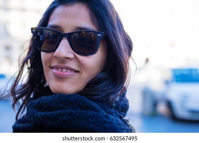 young woman happy in the city