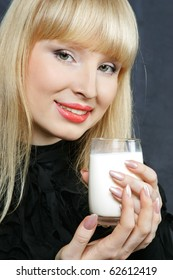young woman with a happy drinks milk