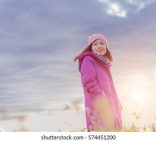 Young woman is happy with the flowers while sunset and winter is coming . Enjoy holiday.