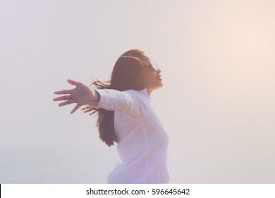 Young woman happy and joyful life. in the sunset.