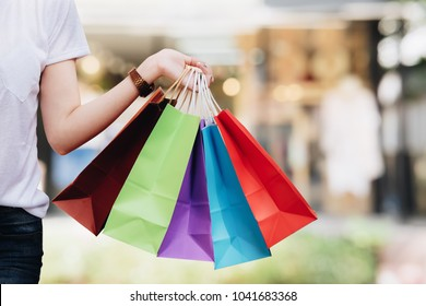 Young woman happy with shopping bags. Easy E-commerce Website Shop by Smartphone, iPhone, iPad and Laptop. Business and modern lifestyle concept