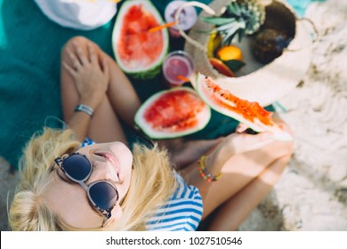 Young woman has a picnic on the beach