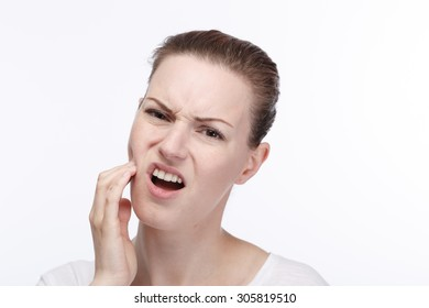 A young woman has a toothache