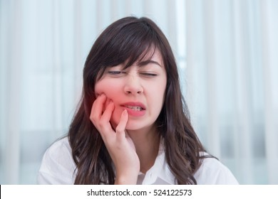 Young  woman has toothache. concept for healthy care