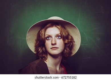Young woman in a hat indoor portrait