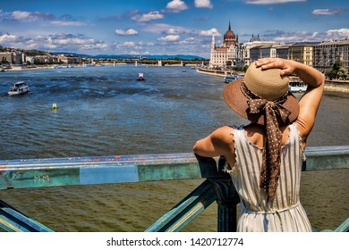 Young woman with hat on Danube river in Budapest, Hungary