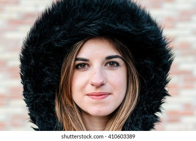 Young woman with a hat on the street