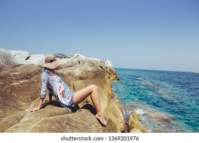 Young woman with hat posing at seaside