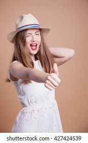 Young Woman in a hat, studio shot