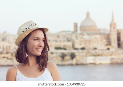 Young woman with hat summer portrait in Valletta, Malta