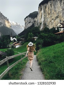 Young woman in hat traveler.  Girl in hat traveler in mountains.