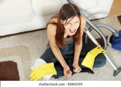 Young woman hates cleaning home.