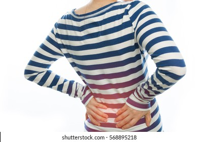 young woman have a backache and touch waist on isolated white background. , concept of healthy lifestyle.
