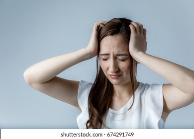 young woman have a headache