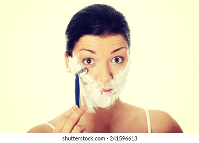 Young woman have morning shave.