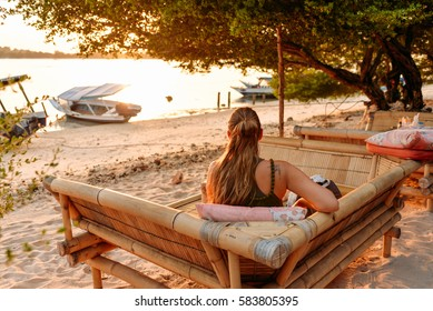 Young woman have a rest in a cafe, Gili Meno, Indonesia