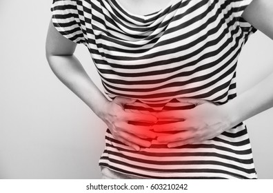 Young woman having abdominal pain, upset stomach or menstrual cramps
