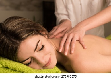 Young woman having a back massage at the spa
