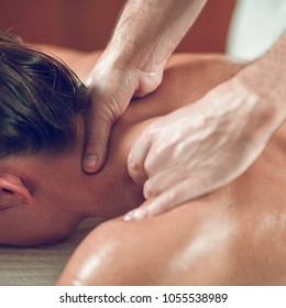 Young woman having back relaxing massage, close up