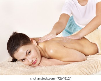 Young woman having classical massage in beauty spa. Series.