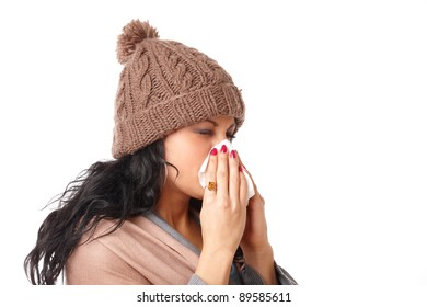Young woman having a cold and sneezing isolated on white background