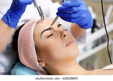 Young woman having face procedures in a beauty salon