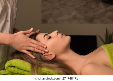 Young woman having a facial massage at the spa