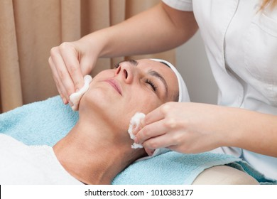 young woman having facial treatment in beauty salon