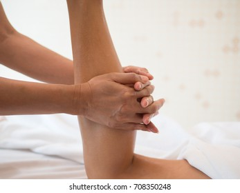 Young woman having feet massage in beauty salon, close up view.Woman giving a good massage to her legs.