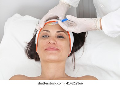 Young Woman Having Fillers Injection For Forehead Lines
