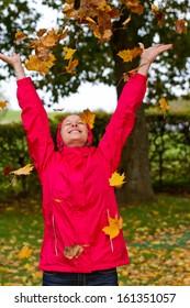 Young woman having fun in autumn