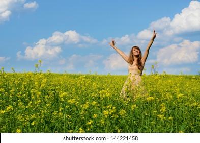 Young woman having fun at canola field