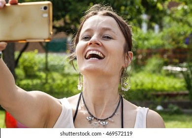Young woman having fun with her smart phone