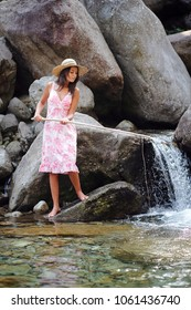 Young woman having fun in a river. Fishing outdoor