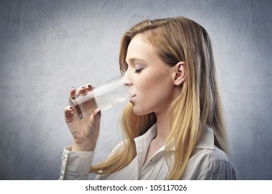 Young woman having a glass of water