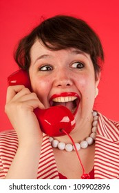Young woman is having good news on the phone