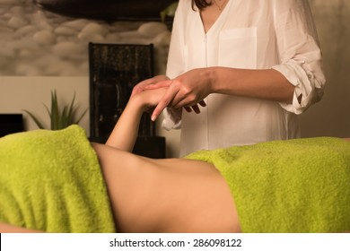 Young woman having a hands massage at the spa